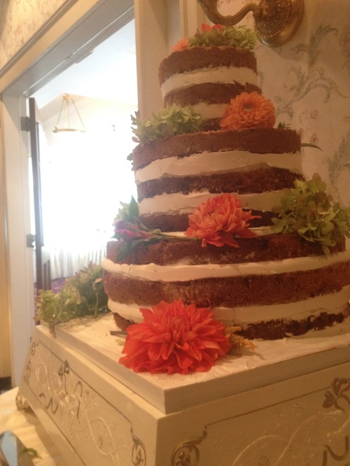 Naked wedding cake with flower decorations