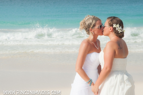 Jett and Chelsea showing their Love and Pride on Flamenco beach in this romantic same sex wedding photograph.