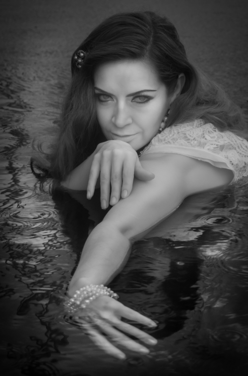Creative Infrared Portrait of Mary Kate in the pool. Portrait and wedding photographer Rincon Puerto Rico.