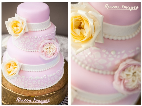 Photograph of a pastel pink wedding cake with white and yellow flower decorations taken by a wedding photographer in Puerto Rico.