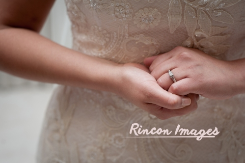 Photograph of a brides wearing a blush white dress and clasping her hands to show off her diamond wedding ring. Photography by Rincon Images photography, wedding photographer in Puerto Rico.