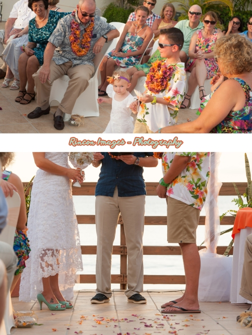 The tropical ring bearer and flower girl walking down the aisle at Villa Cofresit Resort and Hotel in Rincon, Puerto Rico. The sunset was perfect for a destination beach wedding in Rincon Puerto Rico. Wedding photography by Rincon Images wedding photography in Rincon Puerto Rico. Wedding photographer Rincon Puerto Rico.