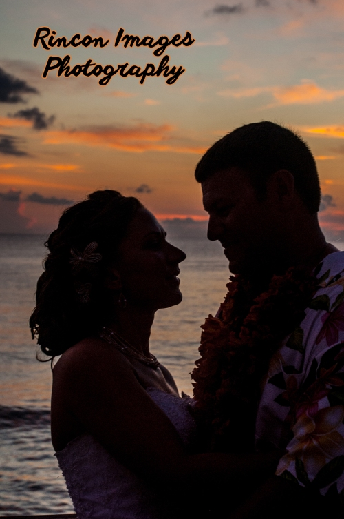 The bride and groom silhouette in front of the sunset after their destination wedding at Villa Cofresi Resort and Hotel in Rincon Puerto Rico.  Wedding photography by Rincon Images wedding photography. Wedding photographer Rincon, Puerto Rico.
