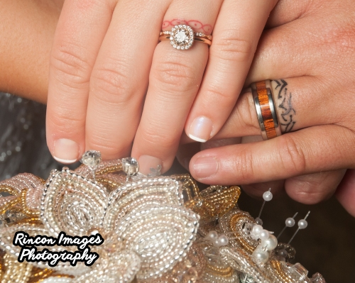 The bride and grooms wedding rings and wedding band tattoos. Wedding photograph by Rincon Images wedding photography. Wedding photographer Rincon, Puerto Rico.