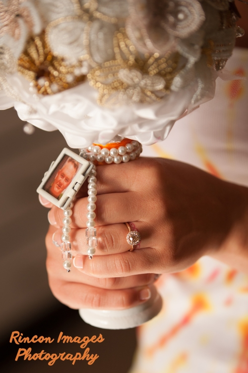 Bride holding a hand beaded bouquet