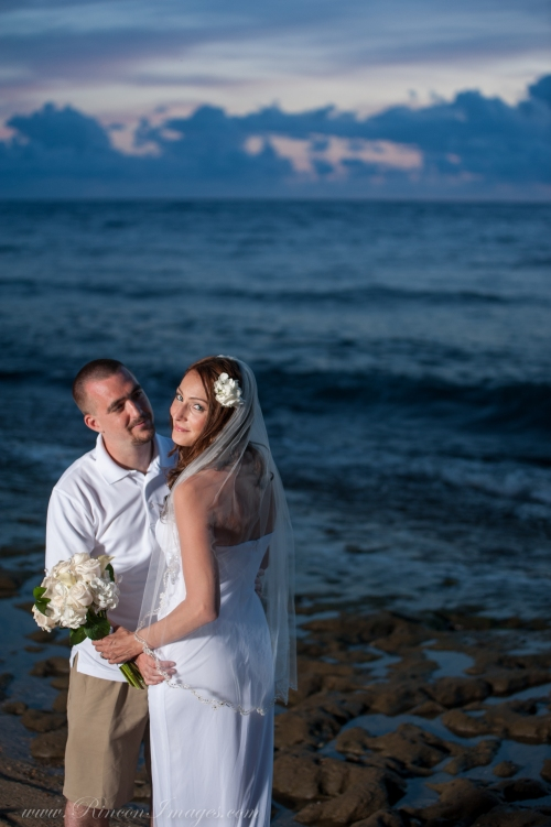 The bride and groom together during their post wedding sunset photo session.