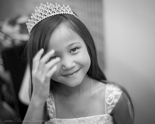 Brookes daughter, the flower girl for the wedding wearing her special tiara as her mom gets ready for the wedding ceremony.