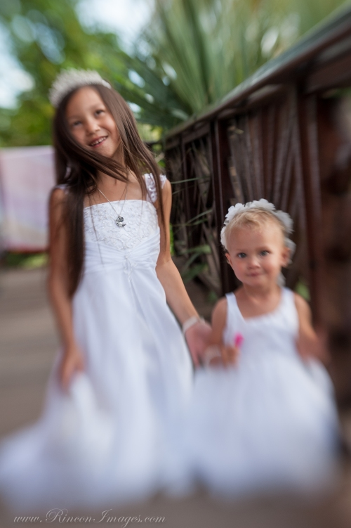 The two beautiful flower girls dressed in white for their mothers Rincon Beach wedding. I absolutely love photographing flower girls during weddings because they are so full of joy.