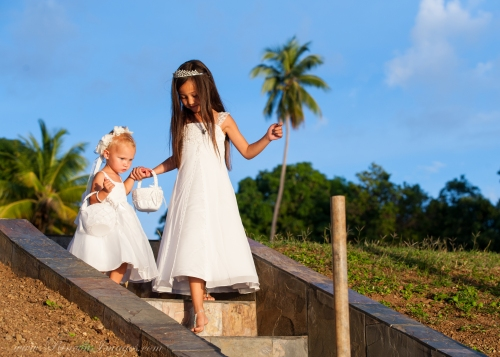Here comes the bride! The flower girls on their way down the isle with the beautiful tropical landscape of Rincon, Puerto Rico behind them.