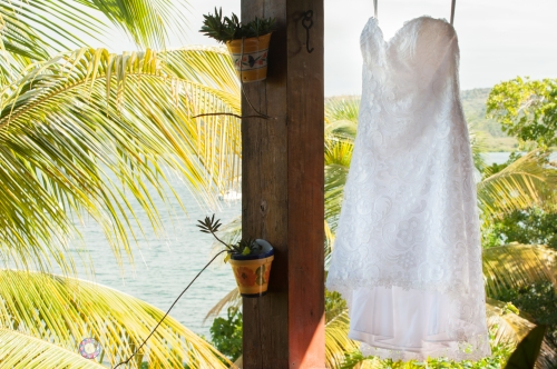 Lyndsays short lace wedding dress blowing in the island breeze. This wedding dress was the perfect choice for their Culebra Island wedding.