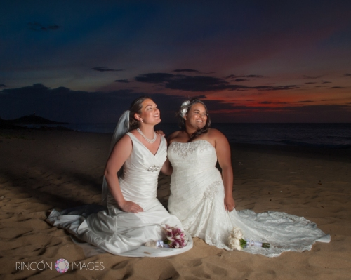 A beautiful sunset with two LGBT brides on the beach in Puerto Rico after their wedding ceremony.