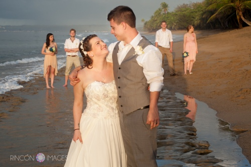 The bride and groom on the beach with their friends after the ceremony. A nice simple, fun wedding with great people.