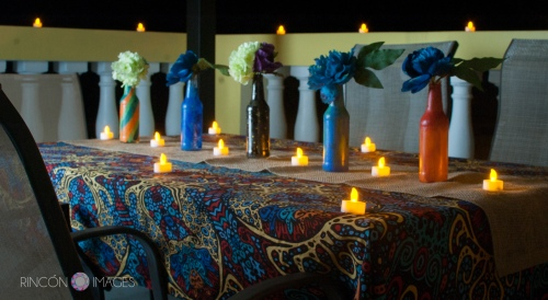 The couple decorated their table with DIY painted bottles and small led tea light candles. The look was very tropical and bohemian.