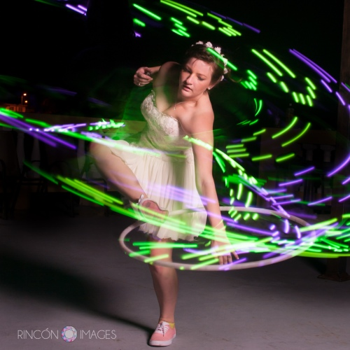 The bride hula hooping with an LED hula hoop after the wedding.