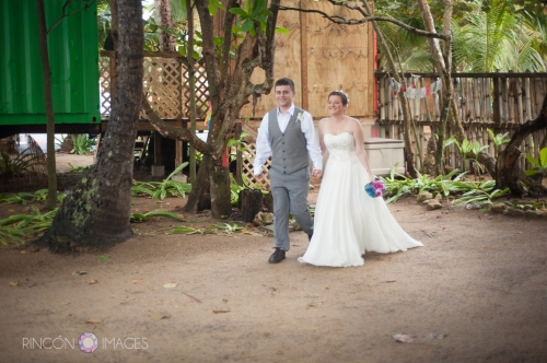 The bride and groom walking down the aisle during their wedding ceremony at the Barefoot Yoga studio in Rincon, PR.