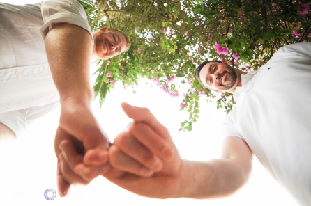 Best friends and partners for life! Cory and Steven are now a happily married couple. I took this playful wedding photograph with my fish eye lens. Photograph by Rincon Images LGBT wedding photographer Puerto Rico.