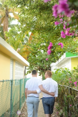 Cory and steven walking towards the ocean together. LGBT wedding photographer Puerto Rico
