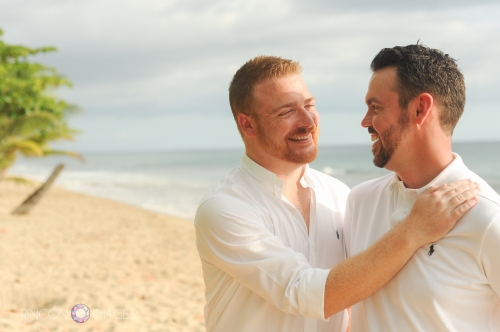 Cory and Steven on the beach in Rincon, Puerto Rico after their gay destination beach wedding in Rincon, Puerto Rico.