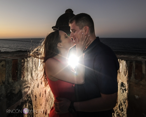 I love using a lens flare in this kind of location, it really adds to the romantic sunset mood. This particular location in Viejo San Juan, Puerto Rico is on Calle Norzagary.  Photography by Rincon Images wedding photographer Puerto Rico.