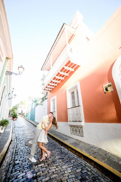 Jerod dips his bride to be on the romantic cobble stone streets of Viejo San Juan. Photography by Rincon Images wedding photographer Puerto Rico.