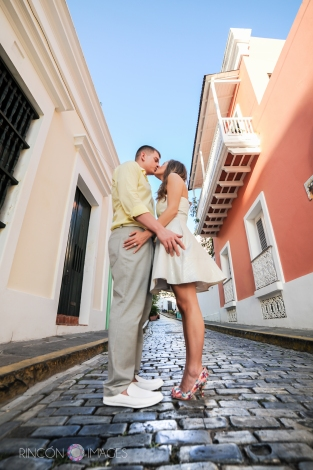 This couple had a blast during their Viejo San Juan photography session. I love using this particular street in San Juan, Puerto Rico to photograph wedding and engagement sessions, it has beautiful colored buildings and almost no cars. Photograph by Rincon Images wedding photographer Puerto Rico.