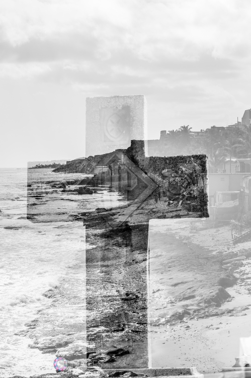 This double exposure is of a tombstone and the view of the coastline from the western part of the cemetery. There is a community in Viejo San Juan called La Perla that you can see from the cemetery.